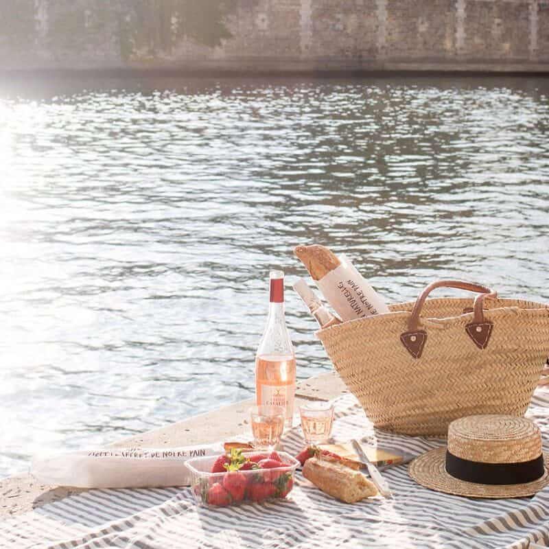 French Market Basket, wine, strawberries, and bread for picnic by the river