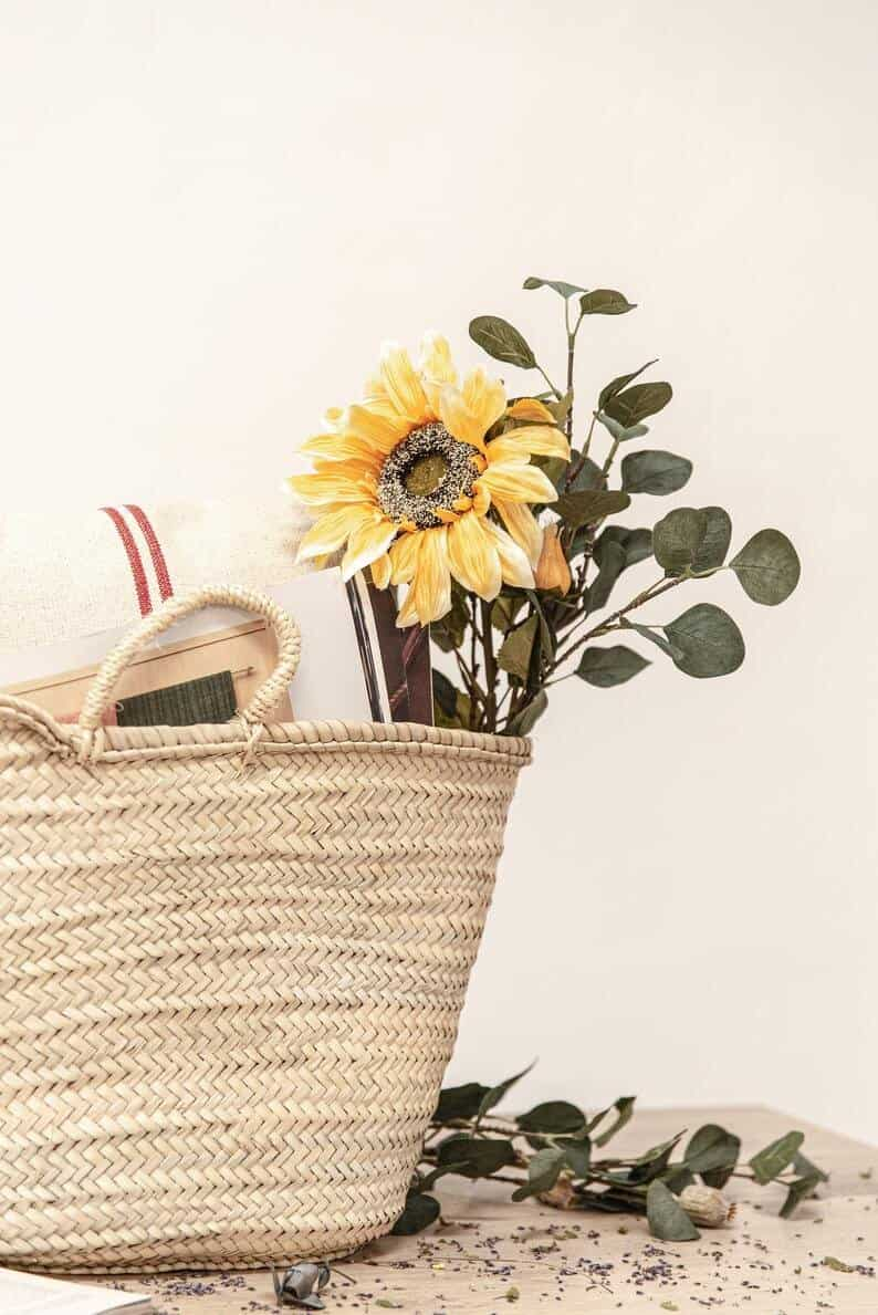 french market basket with flowers and book inside