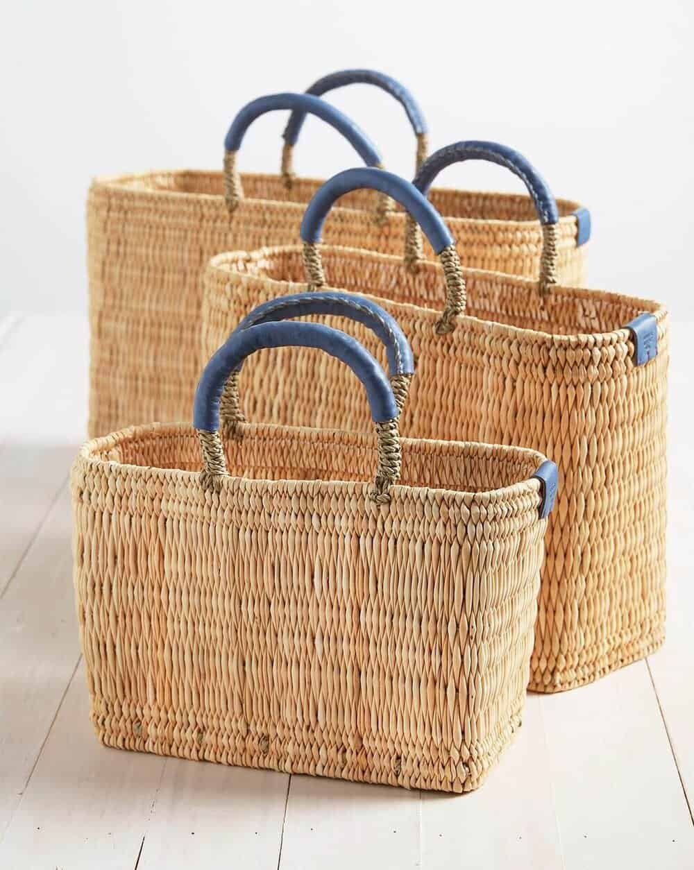 3 baskets for everyday parisian use with blue handles