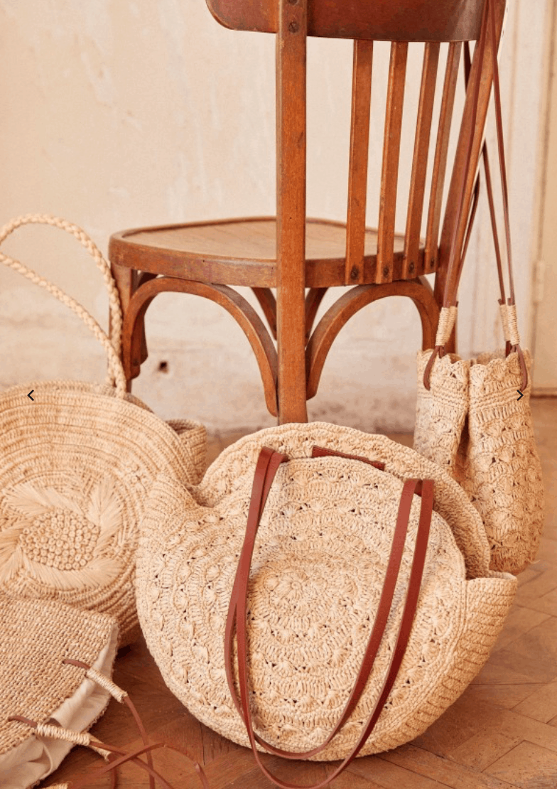 four different designs of french market baskets and a wood chair
