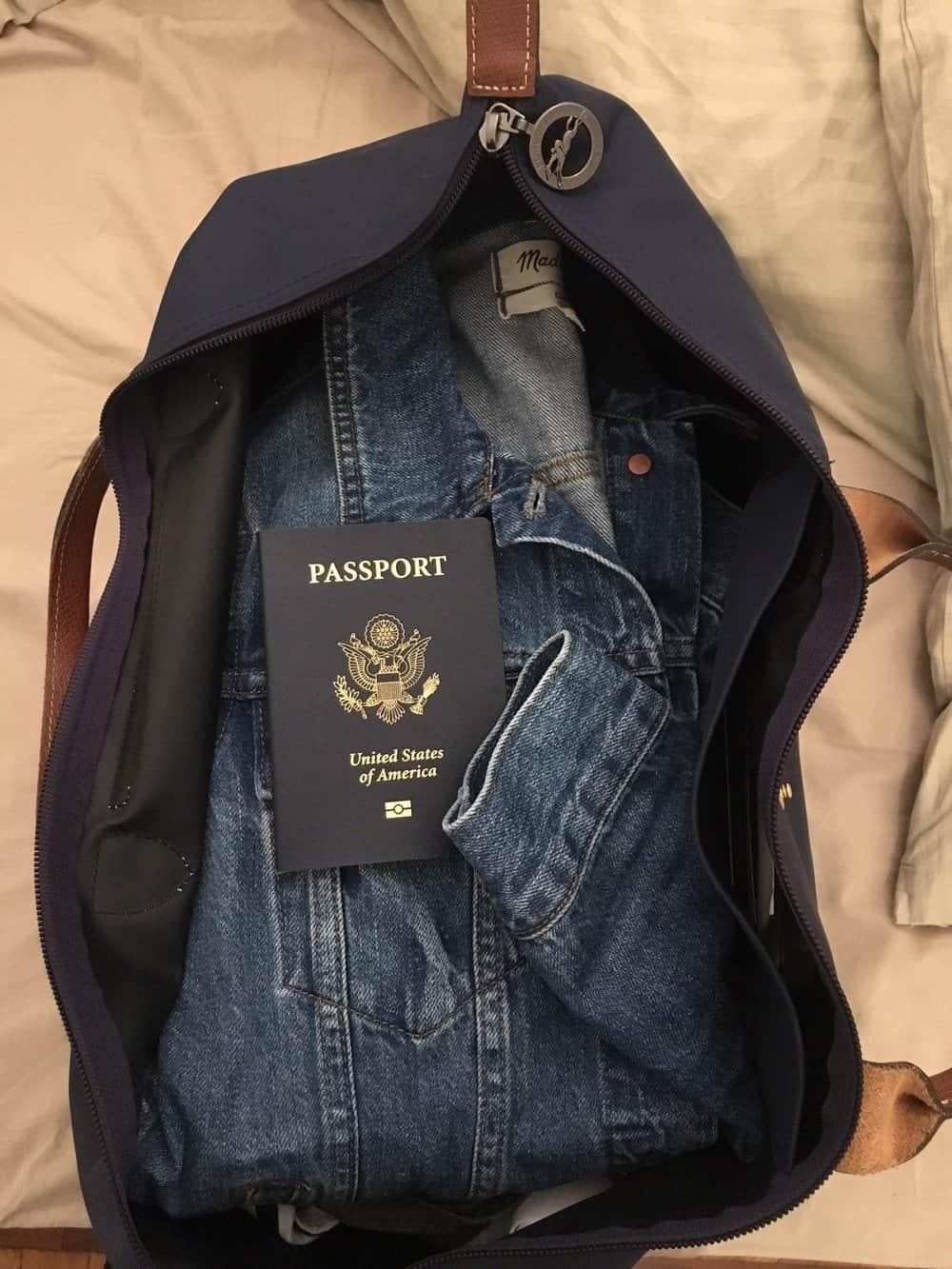 Longchamp Travel Bag  /   Madewell Denim Jacket