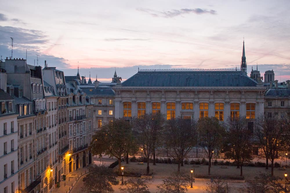 sunrise over place dauphine in paris france. by rebecca plotnick