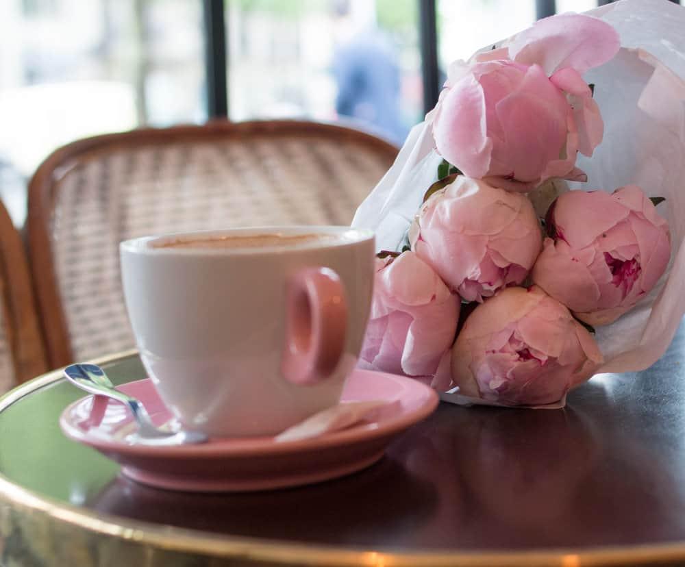 pink peonies and coffee in paris, france