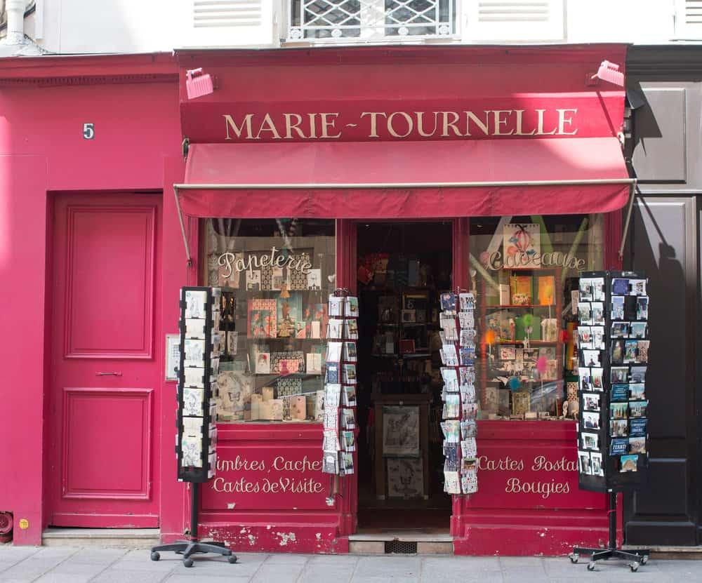 postcards paris red storefront on ile st louis via rebecca plotnick