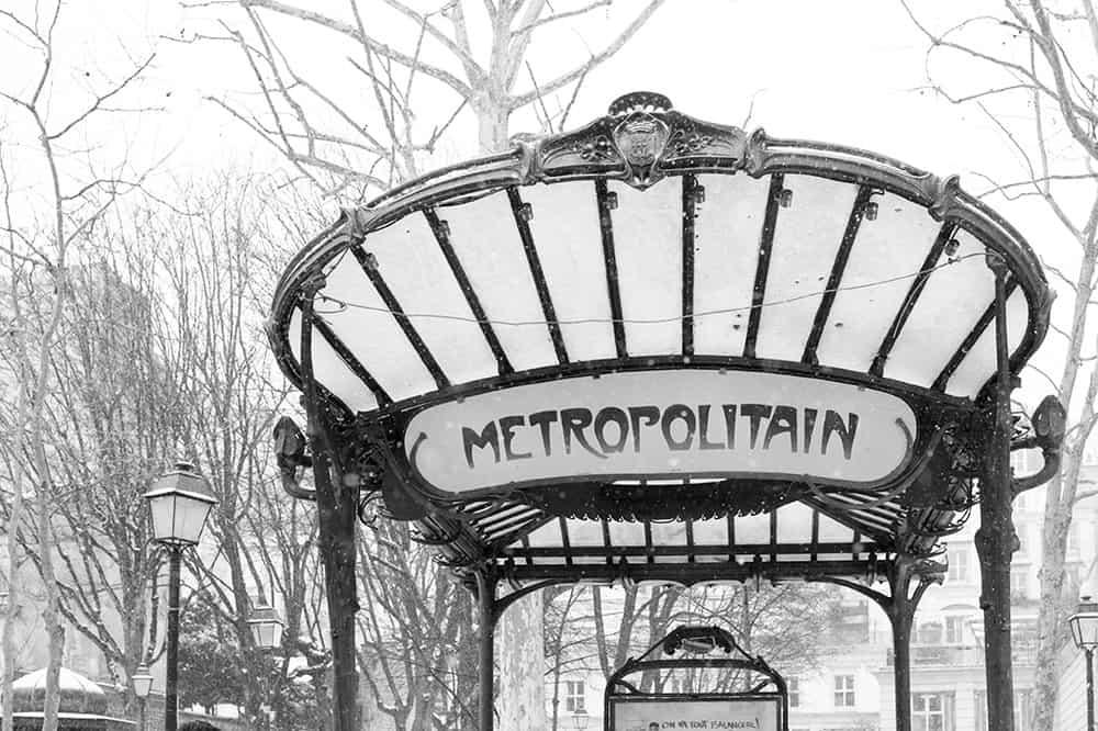 metro on rue des abbesses in the snow @rebeccaplotnick