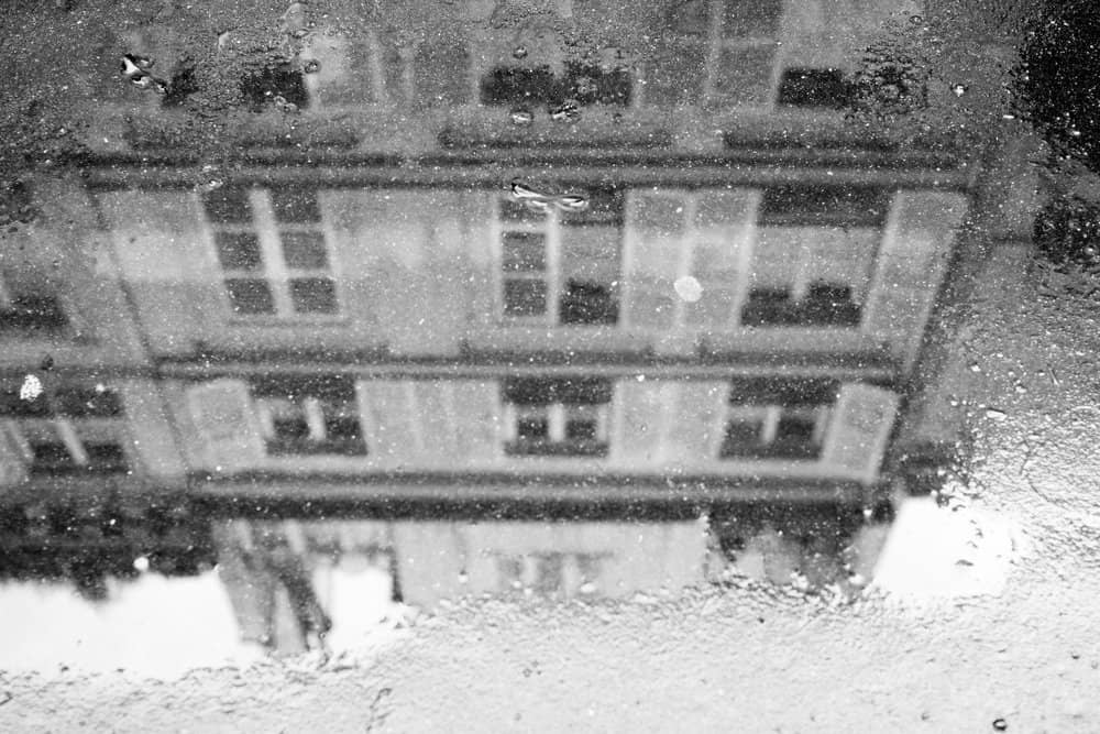 paris rain reflection in puddle