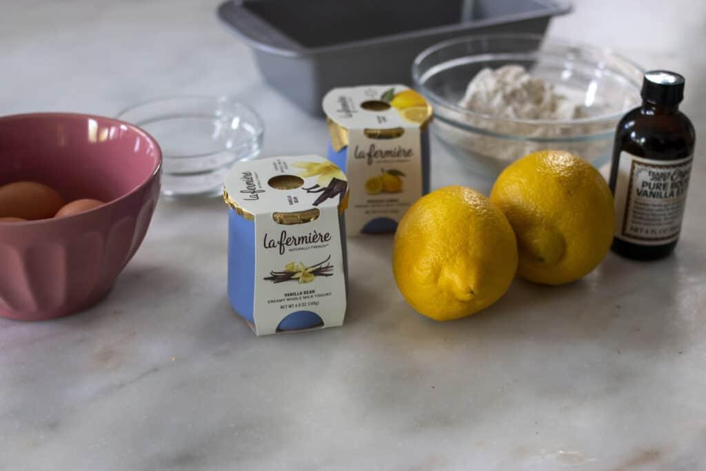 ingredients for Lemon Yogurt Cake including yogurt, eggs, lemon, and flour