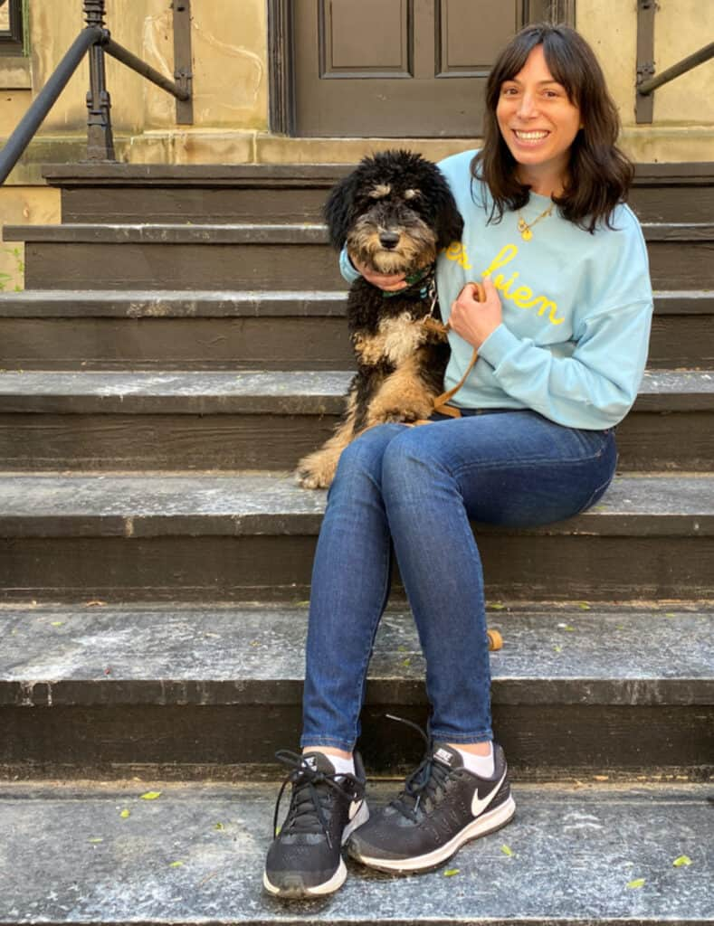 woman and her dog sitting in the stairs for Loved the Most in April