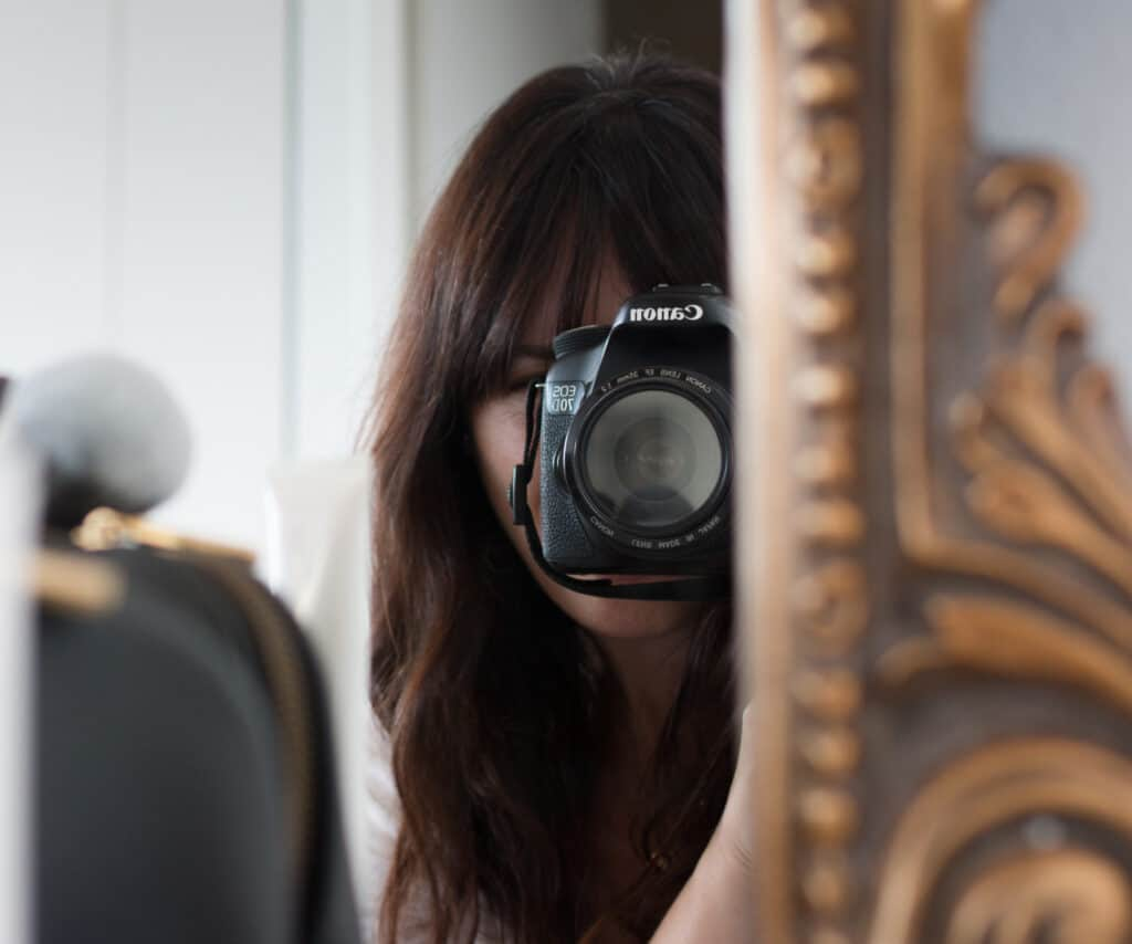woman taking a self portrait for Reader Questions Answered
