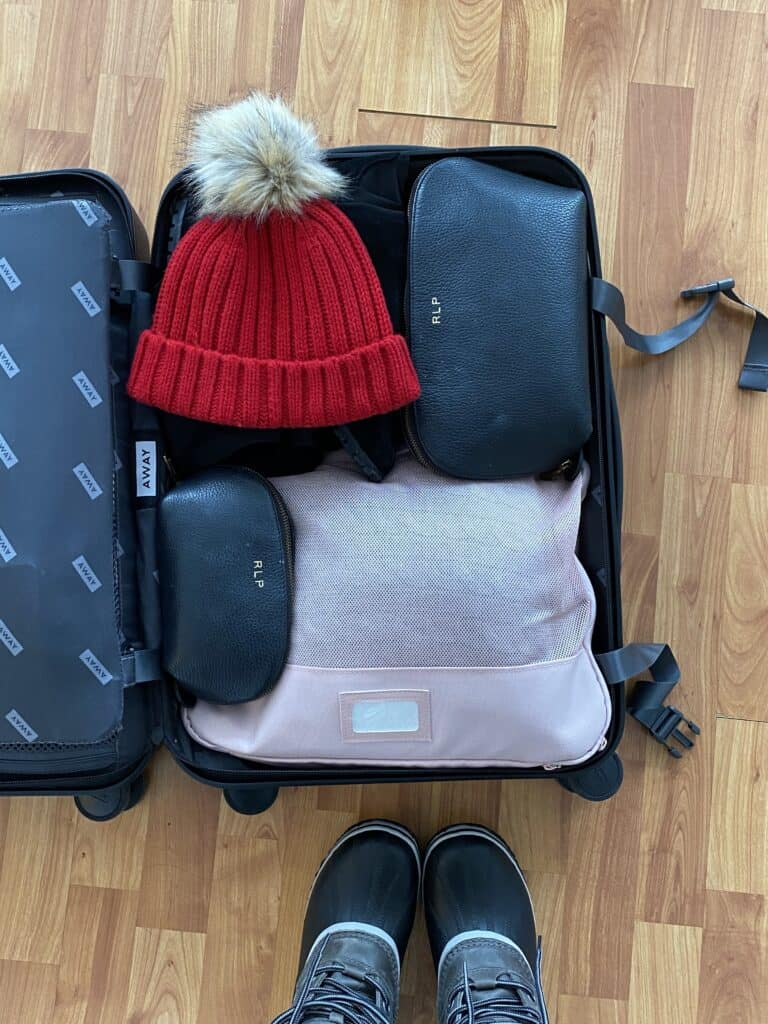 an open suitcase with content inside for how to Pack in a Carry-On