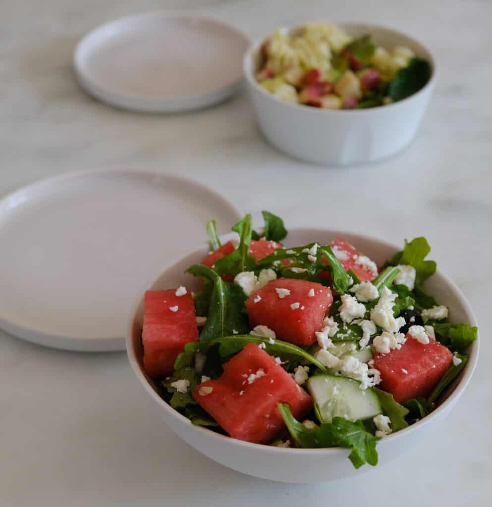 watermelon feta salad on a white bowl