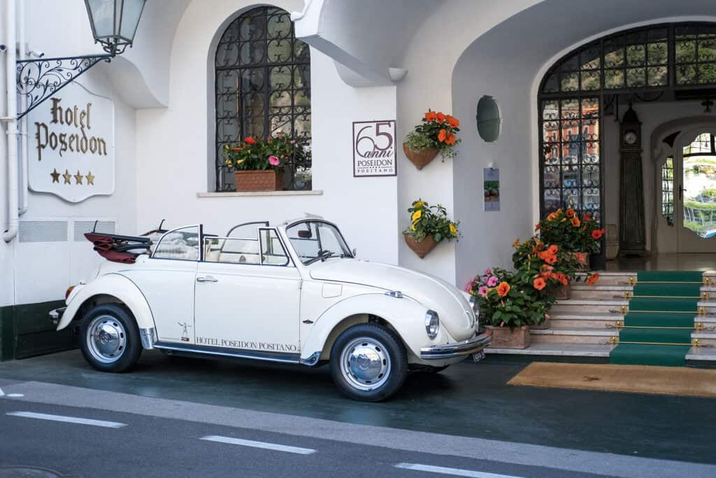 white car outside the hotel poseidon