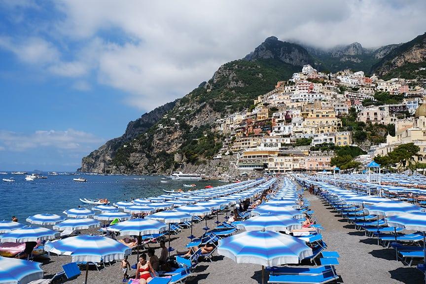 beach umbrellas in the shore for Amalfi Coast Guide