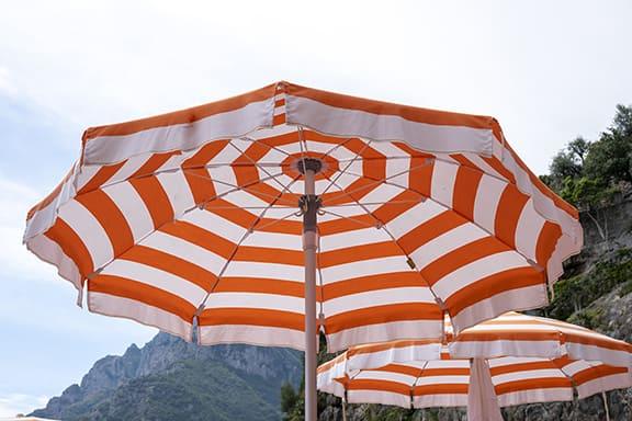 white and orange stripe umbrellas