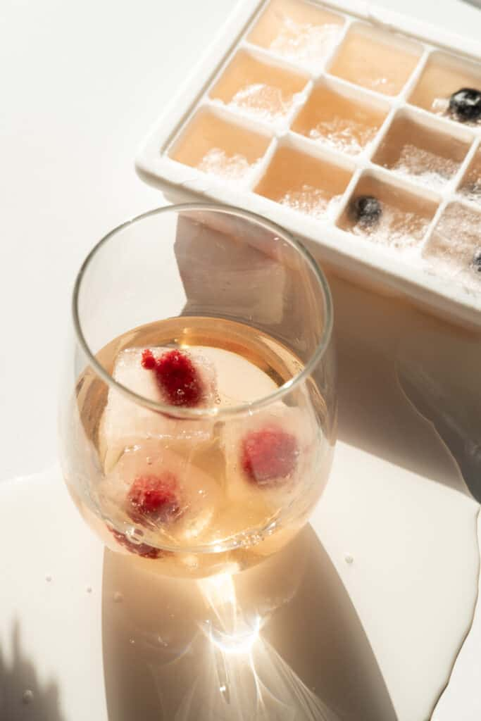 wine glass with wine and Rosé Iced Cubes