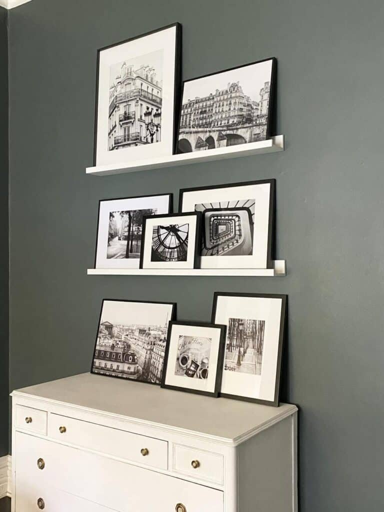 black and white frame set on a gallery wall