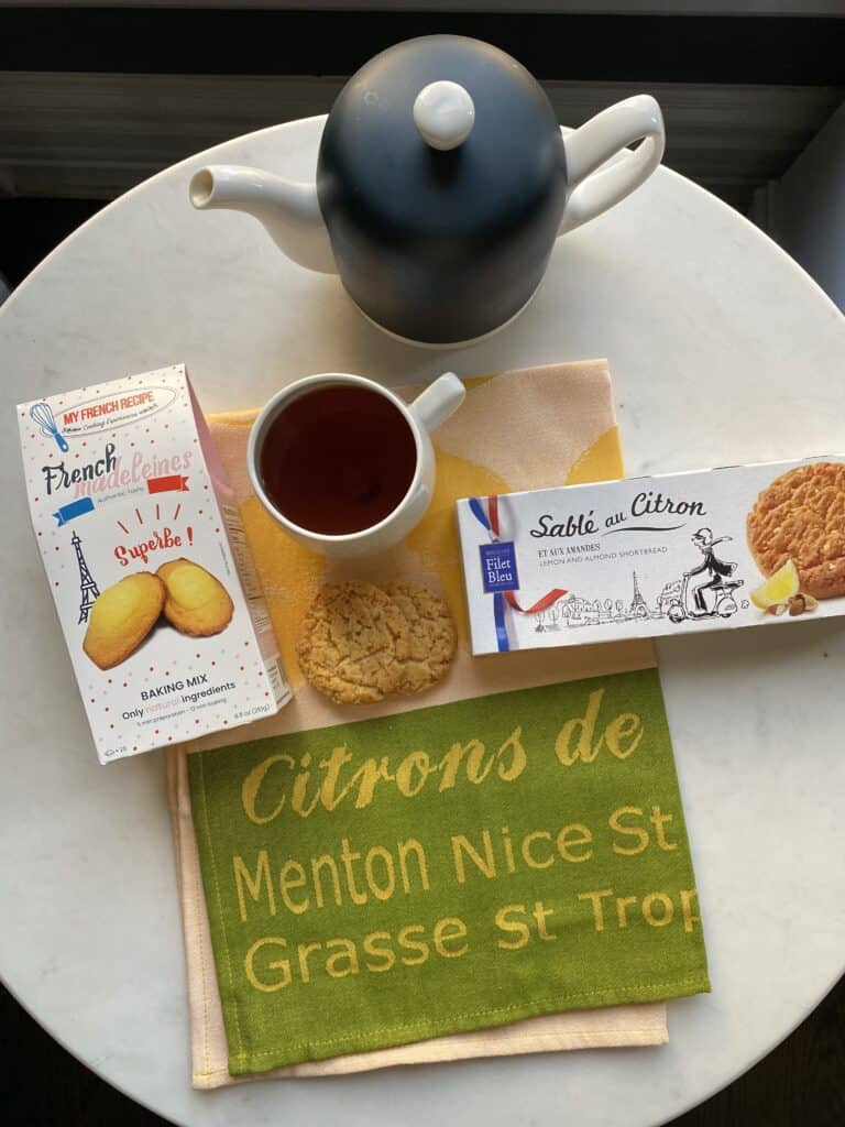 tea and cookies on a table for candle for transition your home for fall