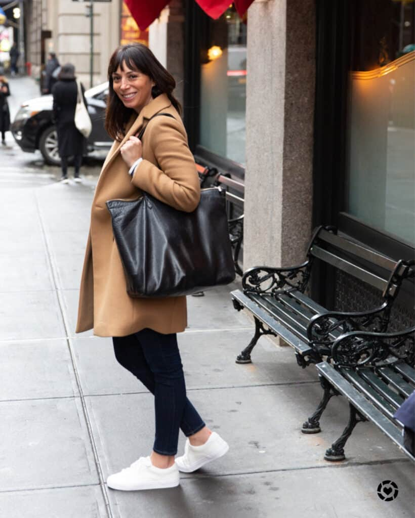 woman wearing coat and sharing what to pack in Paris for fall