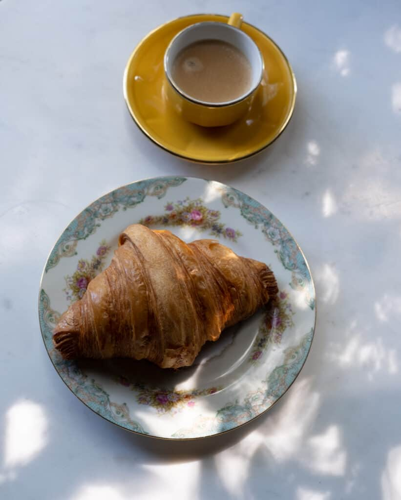 Frenchify Your Breakfast with coffee and croissant