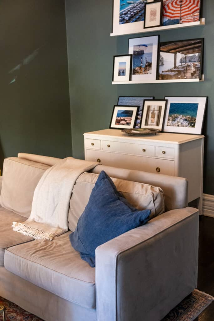 living room with sofa and framed photos