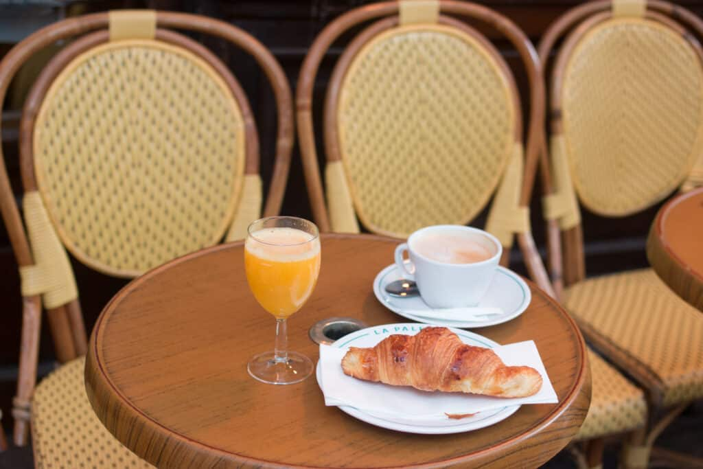 croissant, coffee, and juice