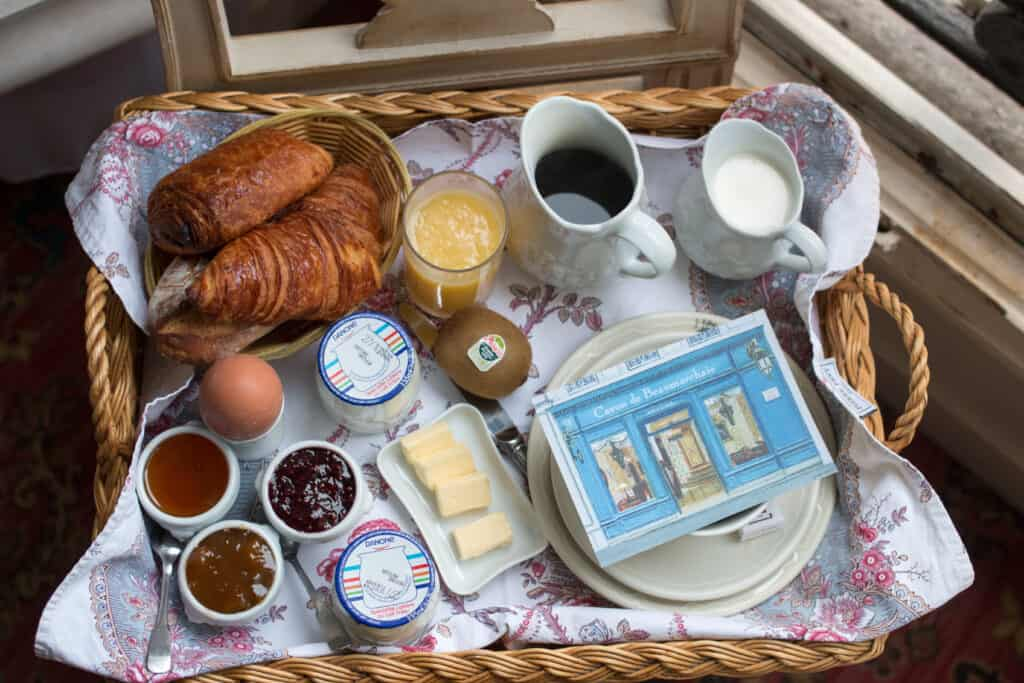 croissant, coffee, egg, cheese, jam, milk and coffee