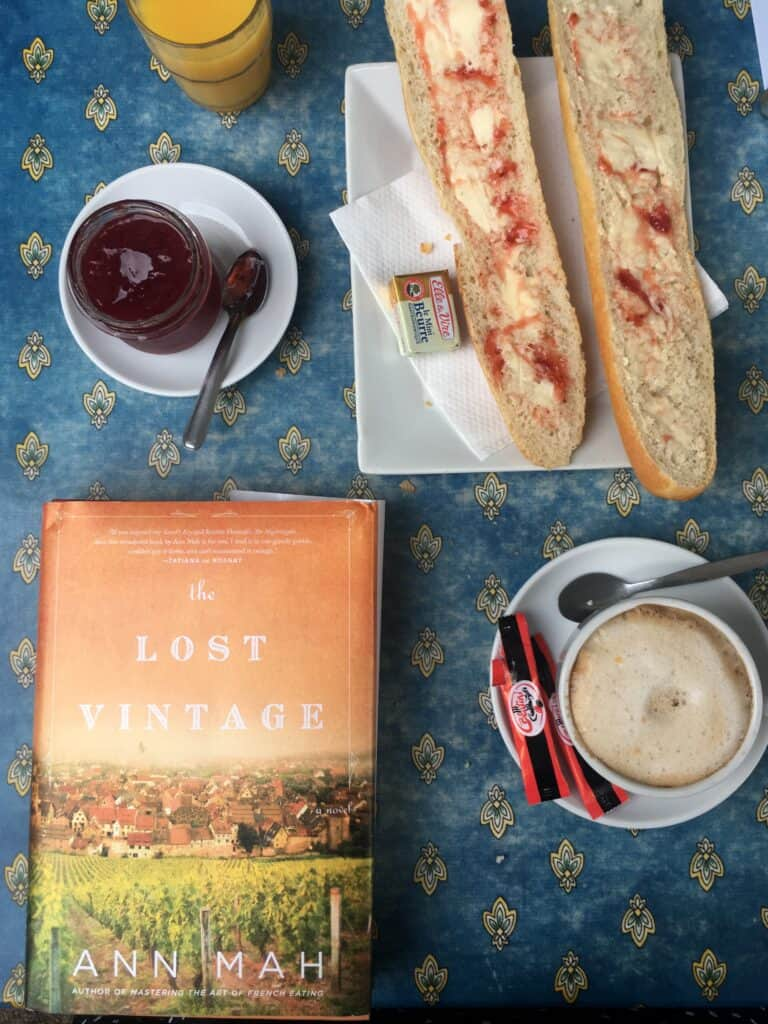 top view of jam, coffee, bread, and a book